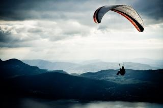 paraglider in sky active Free Photo