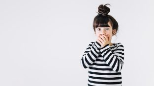 Shocked girl covering mouth Free Photo