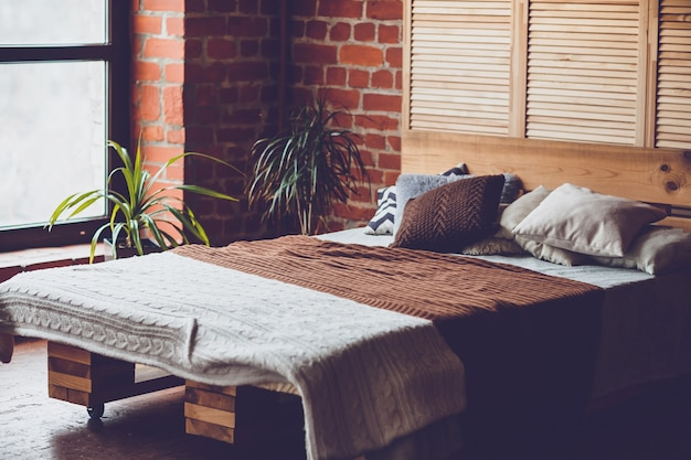 Simple Bedroom With Double Bed Red Brick Wall And Big Window Premium Photo