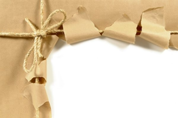 Torn open package with a bow Photo | Free Download