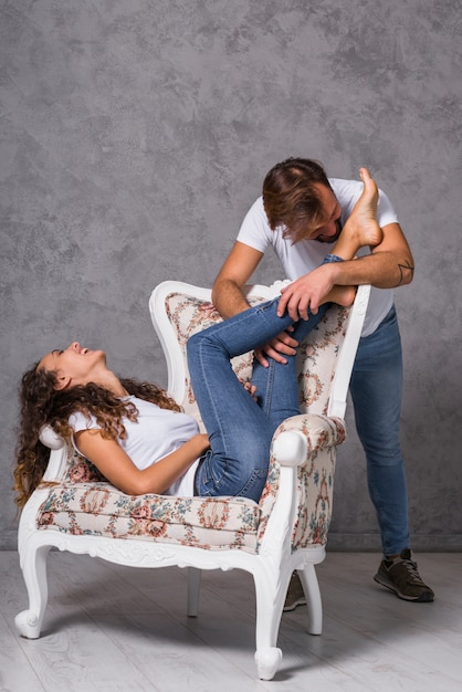 Young man kissing woman feet Photo | Free Download