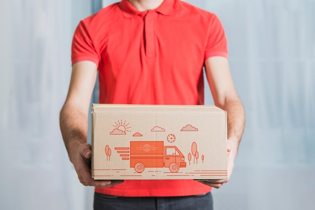 Download Delivery mockup with man holding box PSD file | Free Download