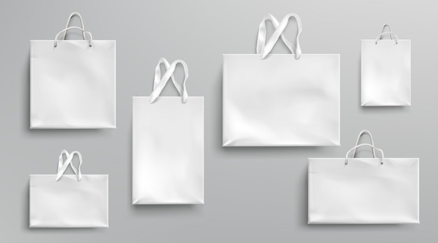 Each psd file comes with several editing options including replacing your own logo design, changing the bag color, contrast and brightness. Free Vector Paper Shopping Bags Mockup White Packages With Rope And Lace Handles Blank Rectangular Ecological Gift Packs Isolated Mock Up For Branding And Corporate Identity Design Realistic 3d Set