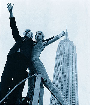 Andy and Edie Sedgewick in front of the Empire State Building