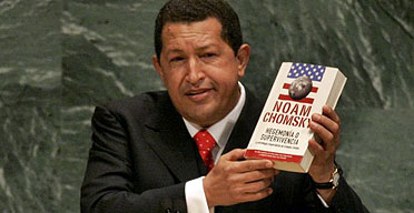 Hugo Chavez holds Chomsky book at United Nations