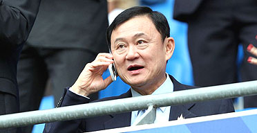 Thaksin Shinawatra watches his club, Manchester City, earlier this month. His lawyer says it is unsafe for him to return to Thailand