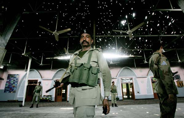 Red Mosque bullet riddled roof, Pakistani soldiers