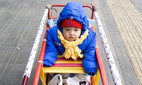 A child sits in a pram in Beijing, China