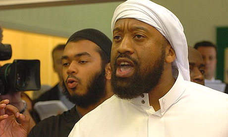 Abu Izzadeen talks to the media after interrupting the speech of home secretary John Reid in August 2006.
