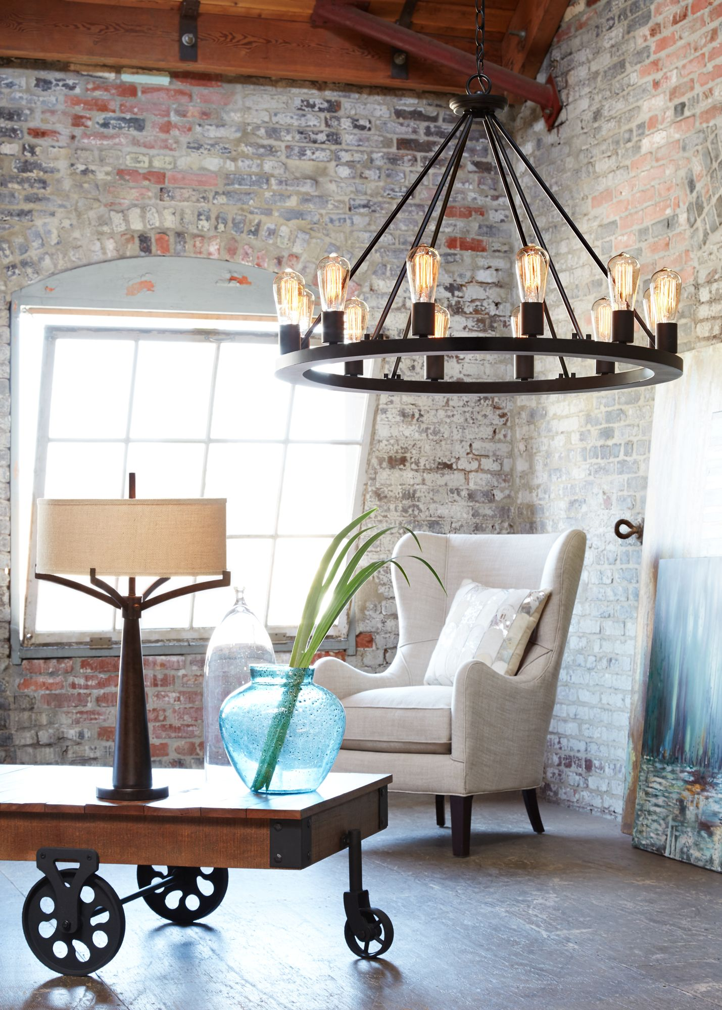 An Industrial Loft Brightened By A Large Chandelier With Edison Style Bulbs Room Inspiration