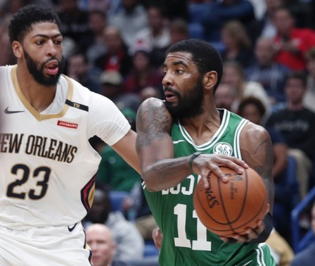 Boston Celtics Guard Kyrie Irving  Works The Ball Against New Orleans Pelicans Forward