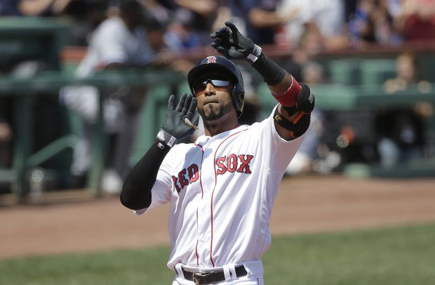 Boston Red Sox's Eduardo Nunez celebrates as he arrives home after hitting a home run off Chicago White Sox's Mike Pelfrey in the first inning Sunday, Aug. 6, 2017, in Boston. (AP Photo/Steven Senne)