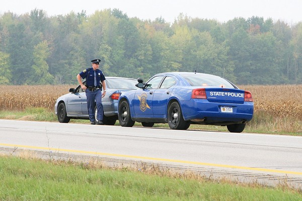 A Michigan State Police Trooper makes a traffic stop. Police in Michigan will begin testing drivers' saliva for the presence of drugs during a pilot program in five counties that begins Nov. 8.