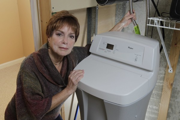 Ro Dobkin and her water softener purchased at and installed by Lowe's. Her basement was damaged when a connector leaked, with water spreading through the finished part of her basement.