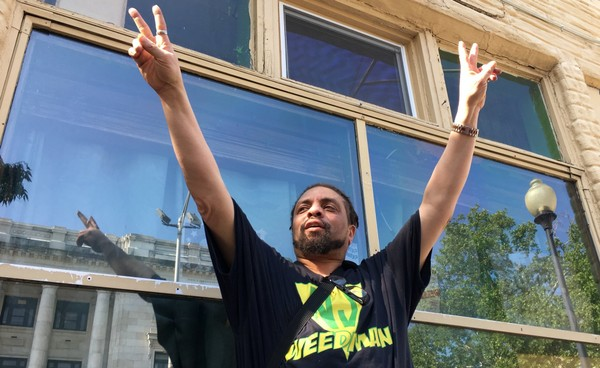 "Ed ""NJ Weedman"" Forchion reacts to someone who beeped their horn in support as he talked in front of his shuttered restaurant Friday, May 25, 2018 in Trenton, a day after he was acquitted of witness tampering and was released from jail. (Kevin Shea 