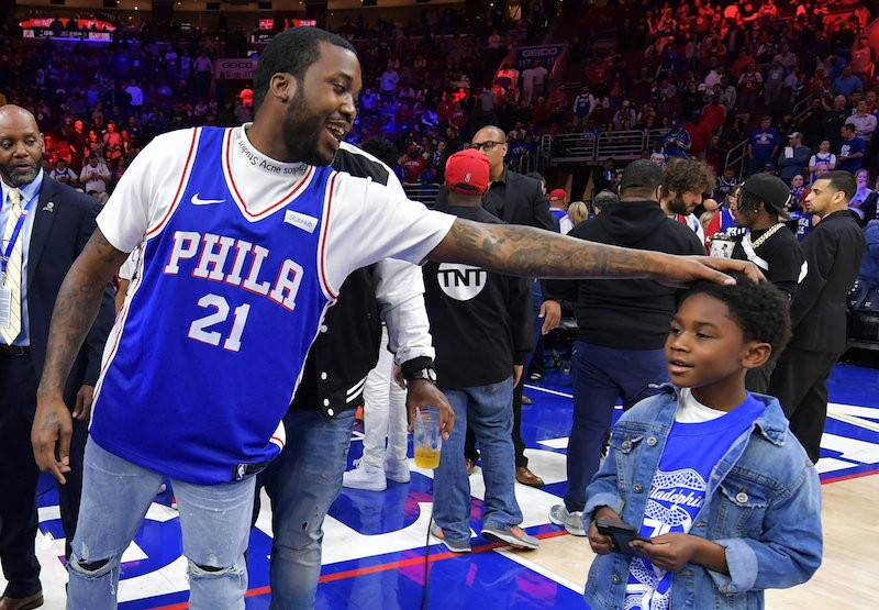 Image result for meek mill and son at 76ers game