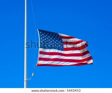 stock photo : United states flag flying at half staff