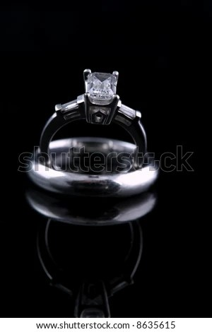 Emerald Cut Engagement Ring With Diamond Begets Sitting