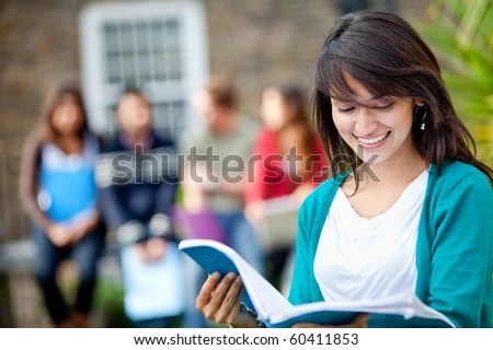 stock photo : Female student outdoors with a group of people on the background