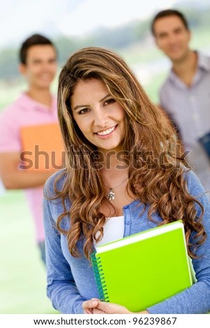 stock photo : Friendly female student looking happy and smiling