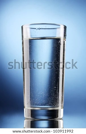 stock photo : glass of water on blue background