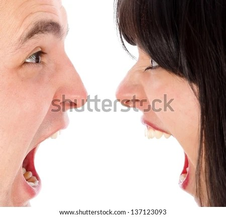 Young couple furiously shouting at each other. - stock photo