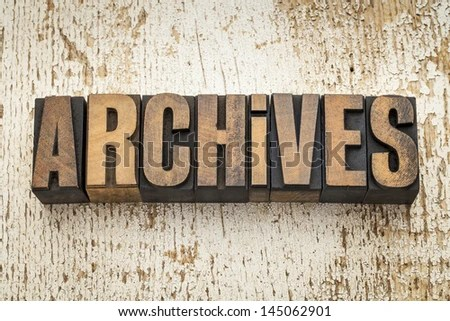 archives word in vintage letterpress wood type on a grunge painted barn wood background - stock photo