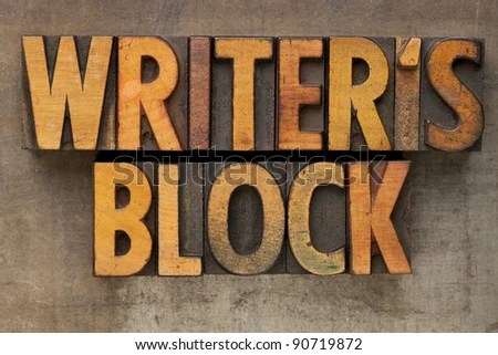 writer block - text in vintage wood letterpress printing blocks stained by color inks on a grunge metal tray - stock photo