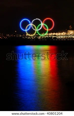VANCOUVER, BC, CANADA - NOVEMBER 11: Vancouver 2010 Winter Olympic Games Rings shine on November 11, 2009 at Burrard Inlet, Vancouver, BC.