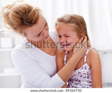 Mother comforting her crying little girl - parenthood concept - stock photo