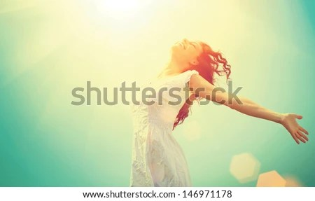 Free Happy Woman Enjoying Nature. Beauty Girl Outdoor. Freedom concept. Beauty Girl over Sky and Sun. Sunbeams. Enjoyment.   - stock photo