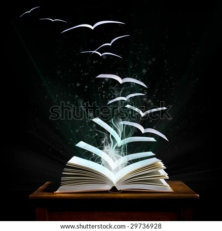The magical world of reading: magic book with pages transforming into birds - stock photo