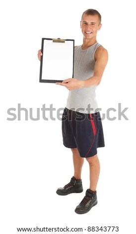 stock photo : young personal trainer keeping balank clipboard, white background