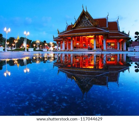 Marble temple at twilight with reflection in a water - stock photo
