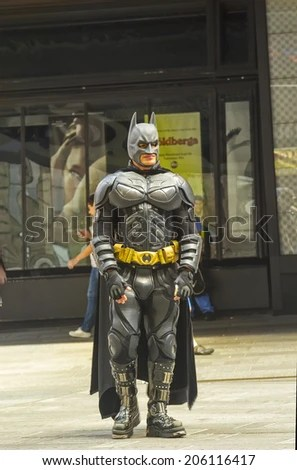 NEW YORK, NY - JUNE 24, 2014:  Batman character in Times Square, greets people and poses for pictures with locals and tourists. - stock photo