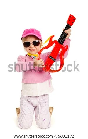 little blond girl playing electric guitar hardcore - stock photo