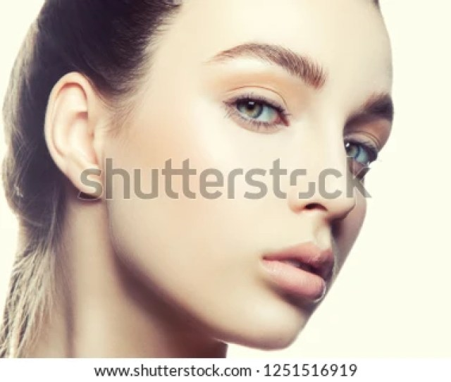 Close Up Beauty Face Of Teen Model Girl Clean Fresh Skin Natural Nude