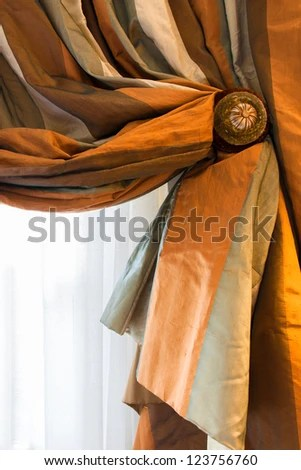 Silk Striped Drape In Rust Cream And Sage Green With Ornate Holdback Close Up Detail Of The