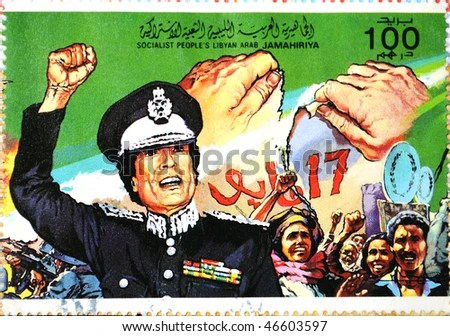 stock photo : The Great Socialist Peoples Libyan Arab Jamahiriya - CIRCA 1995: A Stamp printed in The Great Socialist Peoples Libyan Arab Jamahiriya shows Colonel Muammar Kaddafi, circa 1995
