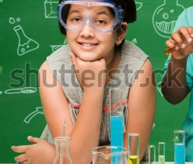 Kids And Science Concept Cute Indian Little Girl Student Studying Science And Experimenting With Microscope