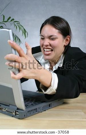 stock photo : Woman mad at computer.