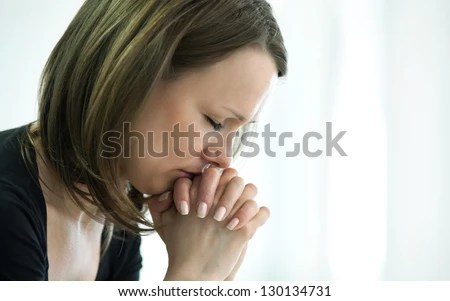 sad young woman crossed  fingers  for her  face in crisis moment - stock photo