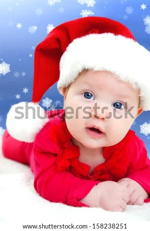 fairy-tale portrait of Christmas baby on winter background - stock photo