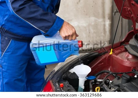 Cropped Image Of Mature Serviceman Pouring Windshield Washer Fluid Into Car At Service Station Stock Photo 363129686 : Shutterstock