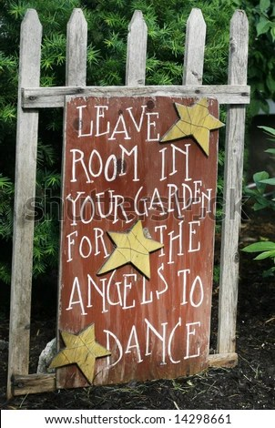 "sign saying ""leave room in your garden for the angels to dance"" - stock photo"
