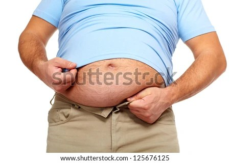 Fat man with a big belly. Diet. - stock photo