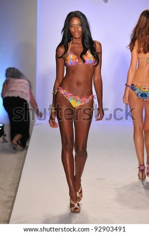 https://i1.wp.com/image.shutterstock.com/display_pic_with_logo/55912/55912,1326755024,3/stock-photo-miami-july-model-walking-runway-at-the-luli-fama-collection-for-spring-summer-during-92903491.jpg