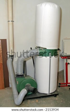 Dust collector in a home woodworking shop. - stock photo