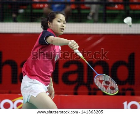 BANGKOK - JUNE 5:Ratchanok Intanon from Thailand participates in a SCG Thailand Open 2013 at Nimitbutr National Stadium on June 5, 2013 in Bangkok, Thailand. - stock photo