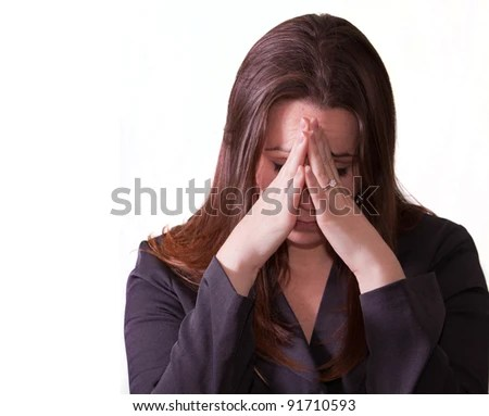 stock photo : A sad woman holding her head